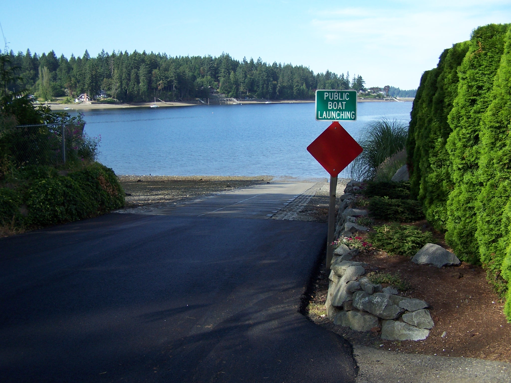 Boat Dock Surrounded By Treen With Traffic Sign