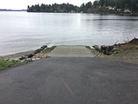 Boat Dock With Concrete Trail and Body of Water