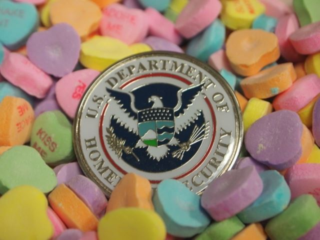 Image of valentine candy and the homeland security logo. Text Prepare because you care.